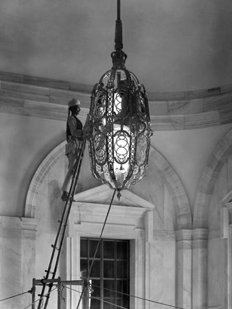 Two Members of the 2000-Strong Viceroy's House Staff Clean One of the Lamps