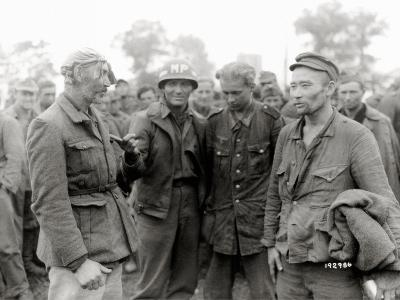 An American Military Police Presents German Pows of Asian Origin