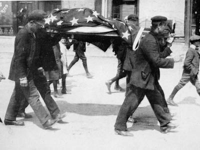 An American Victim of the Sinking of the Lusitania Being Carried Away