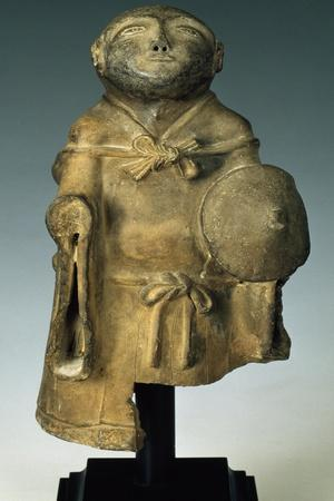 Statuette Depicting Traveling Monk