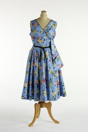 Blue Dress Printed with a Pattern of Ladies Wearing Full-Skirted Dresses, C.1958