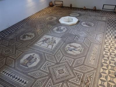 Floor Mosaic with Medallions Depicting Scenes of Combat Between Gladiators