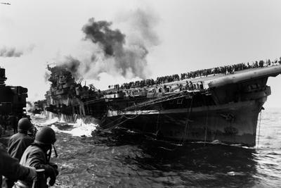 USS Franklin Aircraft Carrier on Fire and Listing after a Strike by a Japanese Dive Bomber
