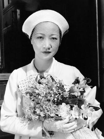 Anna May Wong Arriving in Hollywood in a Travelling Costume of White Herringbone Linen