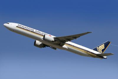 A Boeing 777 of Singapore Airlines in Flight over Italy