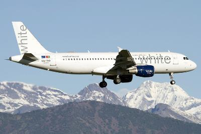 An Airbus A320 of White Airways Flying over Italy