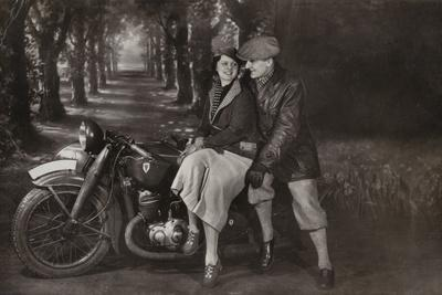 Couple with a Motorcycle and Sidecar