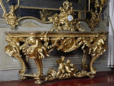 Gilt and Carved Wood Console and Mirror with Figures of Cherubs and Garlands, and Bronze Clock