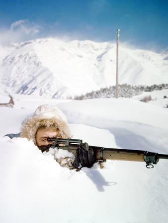 United States Sergeant Douglas C. Dillard with Rifle in the French Alps, December 1944