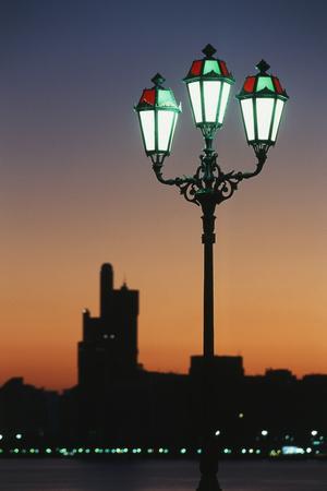 Uae, United Arab Emirates, Abu Dhabi. City and Arabic Streetlamps