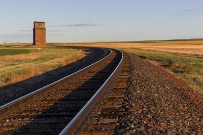 Railroad Tracks Lead to Old Wooden Granary in Collins, Montana, Usa