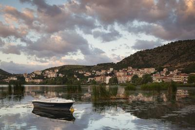 Greece, West Macedonia, Kastoria, Town by Lake Orestiada with Boats