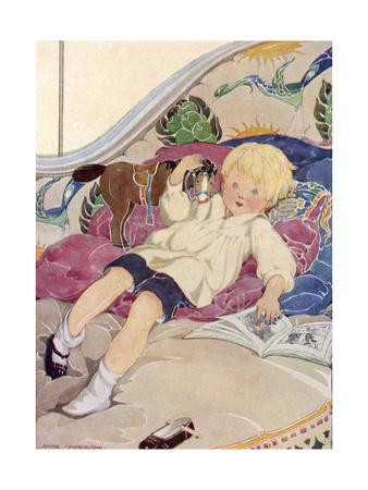 A Boy Lying on a Bed with a Book and a Toy Horse
