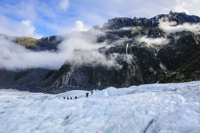 Tourist Hiking on Fox Glacier, Westland Tai Poutini National Park, South Island