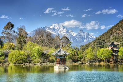 Pagodas with Yu Long Xue Shan (Jade Dragon Snow Mountain) in Jade Spring Park in Spring