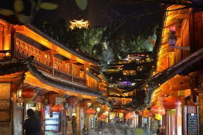 Busy Lijiang Old Town, at Night with Lion Hill and Wan Gu Tower, Lijiang, Yunnan, China, Asia