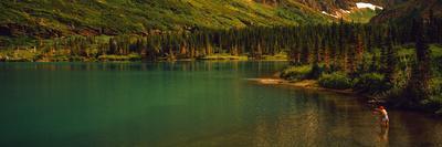 Man Fly Fishing on the Bullhead Lake, Swiftcurrent Valley, Us Glacier National Park, Montana, USA