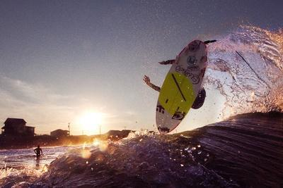 A Young Man Surfing on the Outer Banks of North Carolina