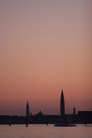 A Warm Sunset Silhouettes the Bell Towers in Venice, Italy