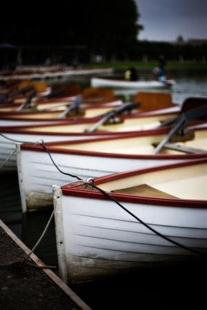 Red and White Boats Lined Along the Shore in Paris, France