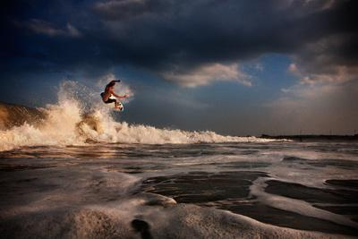 A Young Man Surfs on a Wave on the Outer Banks of North Carolina