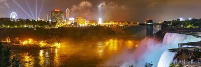 Niagara Falls Illuminated with Colored Lights, and Attractions on the Far Shore at Night