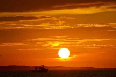 A Boat Silhouetted by a Blazing Hot, Fiery, Hellish But Gorgeous Sunset