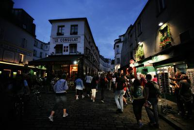 Crowds Fill the Streets of Paris at Night