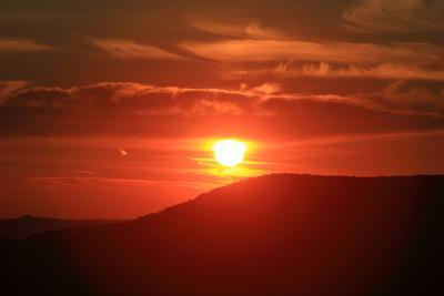 A Dramatic Fiery Sunset over a Flat-Topped Hill