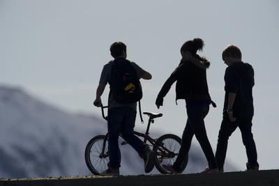 Kids with a Bicycle, in Silhouette
