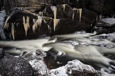 Icicles Hover over the Ausable River in Winter