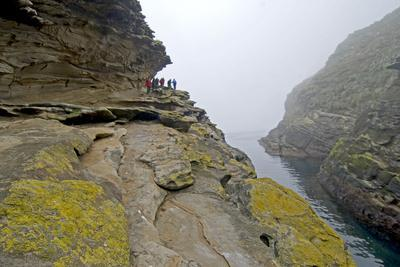 Tourists Explore an Eerie Gorge Below the Devil's Nose