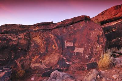 A Rock Covered in Petroglyphs at Sunset