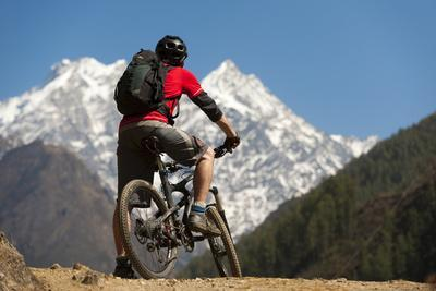 A Mountain Biker in the Tsum Valley Looks at Ganesh Himal Mountains