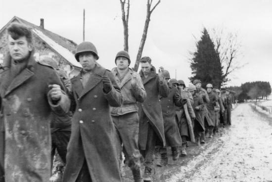 American Prisoners of War are Marched Along a Road During ...