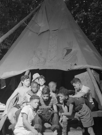 Racially Integrated Group of Boys Sharing a Comic Book at Camp Nathan Hale in Southfields, NY