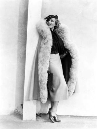 Marlene Dietrich, in a Brown and Beige Suit and Lynx-Trimmed Beige Wool Cape by Travis Banton, 1935
