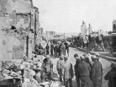 Captive German Prisoners Removing Debris from the Streets of Clermont-En-Argonne, France, 1914