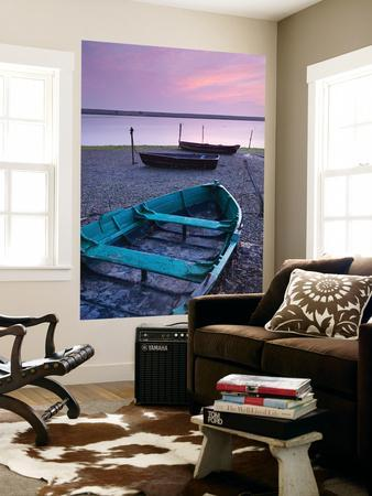 Boats at Low Tide on the Shore of the Fleet Lagoon, Chesil Beach, Dorset, England. Spring