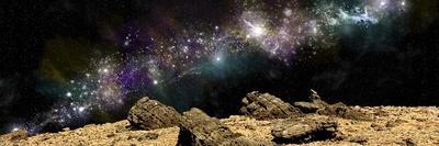 A Colorful Nebula Above a Rocky and Barren Alien World