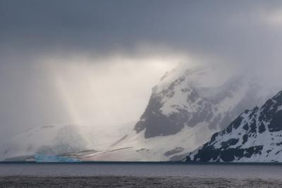 Antarctica. Bransfield Strait. Iceberg under Stormy Skies