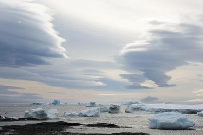 Antarctica. Brown Bluff. Lenticular Clouds Show Katabatic Winds