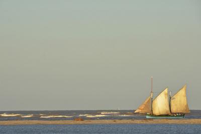 Madagascar, Morondava, Fisherman Boat with Large White Sails at Sea