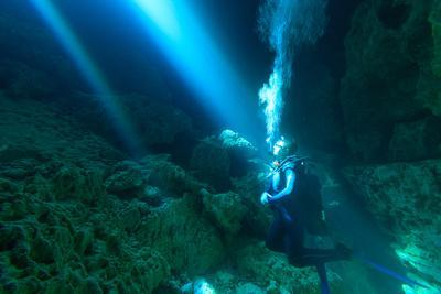 Sunrays Shine on Scuba Diver in the Devils Den Spring, Florida