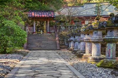 Stone Path Leading to Red Japanese Temple