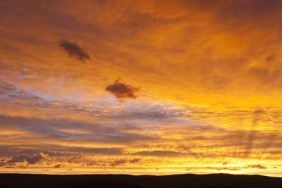Wyoming, Sublette County, Sunset over Silhouetted Ridgeline