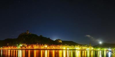 Cochem Castle at Night, with a Flaring Satellite Overhead. City Lights in the Moselle River