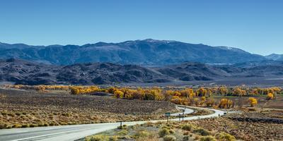 A Road Through and Autumn Landscape Headed Towards the Sierra Nevada Mountains