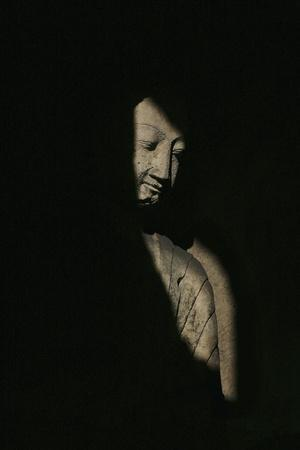 Buddha Statue in Shadows, Yungang Caves,Wuzhou Shan Mountains,China