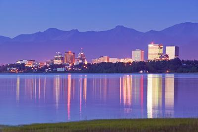 View of Downtown Anchorage Skyline across Knik Arm with Reflection at Sunset Southcentral Alaska Su
